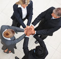 Group of business people joining hands together Royalty Free Stock Images