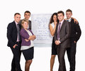 Group of business people looking at the graph on smiling flipchart Stock Photography