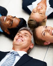 Group of business people lying on the floor Royalty Free Stock Images
