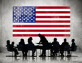 Group of business people meeting with american flag Stock Photography