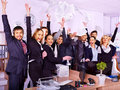 Group business people in office happy with hand up Stock Photo