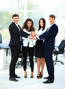 Group of business people piling up their hands together in the workplace Stock Images