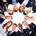 Group of business people standing in huddle, smiling, low angle Royalty Free Stock Photography