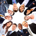 Group of business people standing in huddle Royalty Free Stock Photo