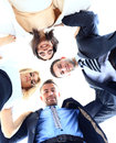 Group of business people standing in huddle smiling low angle view Stock Photos