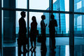 Group of business people standing in lobby or hall a city skyline the background silhouette shot Stock Images