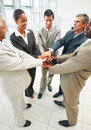 Group of business people with their hands joined Stock Images