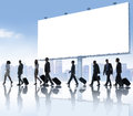 Group of business people travelling with placard Stock Photography