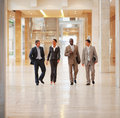 Group of business people walking together Stock Photos