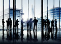 Group of business people working indoors silhouettes multi ethnic together Royalty Free Stock Photos