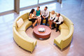 Group Of Businesspeople Having Meeting In Office Lobby Royalty Free Stock Photo