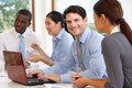 Group Of Businesspeople Meeting Around Boardroom Table Royalty Free Stock Photo