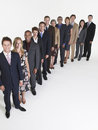 Group of businesspeople in row full length portrait multiethnic a against white background Royalty Free Stock Images