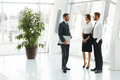 Group of businesspeople standing together business team communicating with each other Royalty Free Stock Image