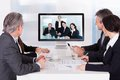 Group of businesspeople in video conference at business meeting Stock Photo