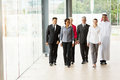 Group businesspeople walking of professional in office building Royalty Free Stock Photos