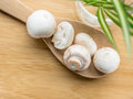 A group of buttom mushroom on wooden spoon and board Royalty Free Stock Photos
