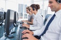 Group of call center agents working in line a bright office Stock Photos