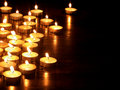 Group of  candles on  black background. Royalty Free Stock Photo