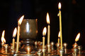 Group Of Candles Burning In The Dark Royalty Free Stock Photo