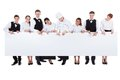 Group of catering staff holding a blank banner large with copyspace for your text including chef waiters waitresses hostess and Stock Image