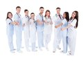 Group of cheerful doctors showing thumbs up Royalty Free Stock Photo