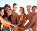 Group of cheerful friends with hands together Stock Images