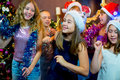 Group of cheerful young girls celebrating Christmas Royalty Free Stock Photo