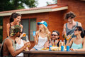 Group of cheerful young people drinking beer and laughing outdoors Royalty Free Stock Photo