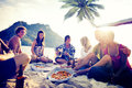 Group of Cheerful Young People Relaxing on a Beach Royalty Free Stock Photo