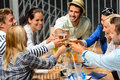 Group cheerful young people toasting drinks night out Stock Image