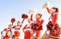 Group of cheerleaders in action with male coach concept unity and team sport training at college high school young female Royalty Free Stock Images