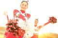 Group of cheerleaders performing at high school camp