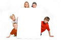 Group of children behind a blank sign on white background Royalty Free Stock Image
