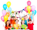 Royalty Free Stock Photo Group of children at the birthday party with raised hands.