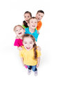 Group of children in colorful t shirts standing happy together top view isolated on white Stock Photography