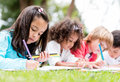 Group of children coloring happy at the park Royalty Free Stock Photography