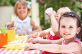 Group Of Children Enjoying Outdoor Tea Party Stock Photos