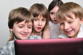 Group of children friends playing computer games Royalty Free Stock Photos