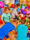 Group children game blocks on floor . Children play in the kids club.
