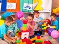 Group children game blocks on floor