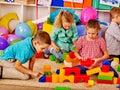 Group children game blocks on floor .