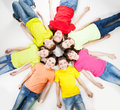 Group children happy isolated at white background smiling teen lying in a circle frendship boys and girls Royalty Free Stock Photos