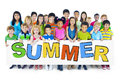 Group of Children Holding Board with Summer Concept