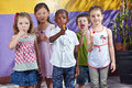 Group of children in kindergarten interracial a eating suckers Royalty Free Stock Image