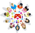 Group of children looking up with gaming symbols Royalty Free Stock Photography