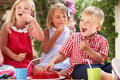 Group Of Children At Outdoor Tea Party Royalty Free Stock Photo