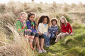 Group Of Children Playing In Field Together Royalty Free Stock Photos