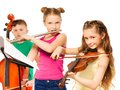 Group of children playing on musical instruments Royalty Free Stock Photo