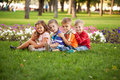 Group of children relaxing and playing in the park a on green grass Stock Photo